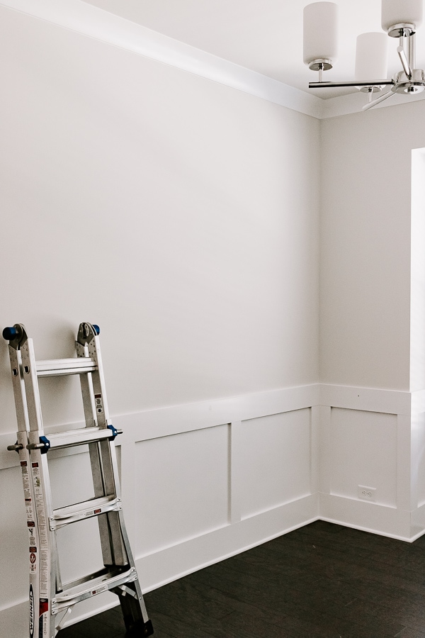 showing a ladder with a blank wall and molding