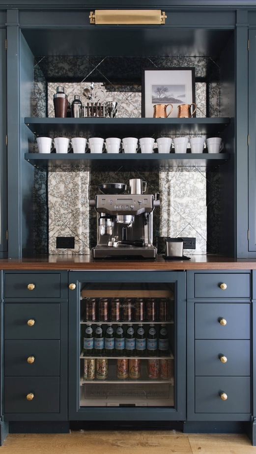 navy cabinets with a row of white mugs