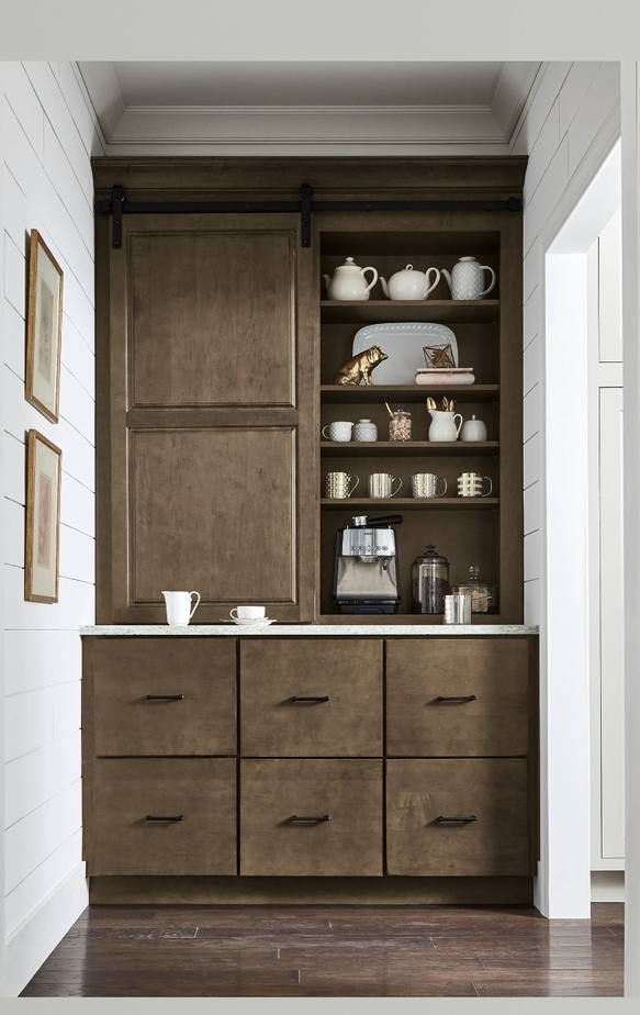 dark walnut cabinets with a coffee maker