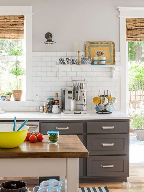 coffee station in a kitchen with green cabinets