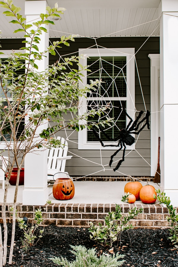 a giant spider web for halloween on a front porch