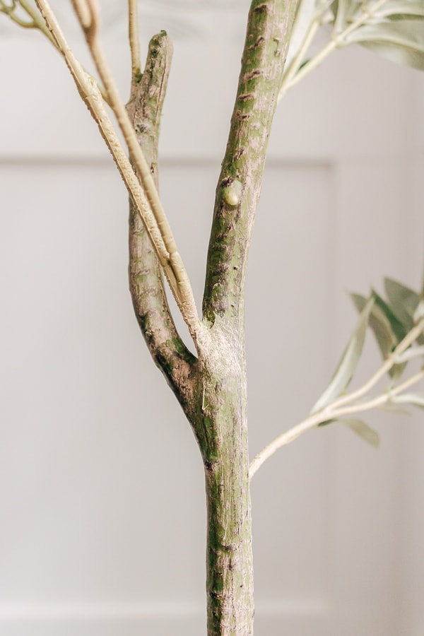 close up of faux branch on olive tree