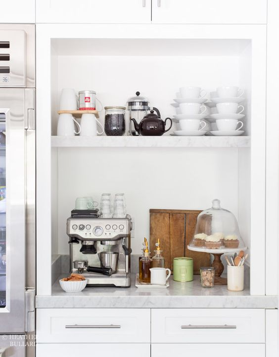 white cabinets with a hidden coffee station