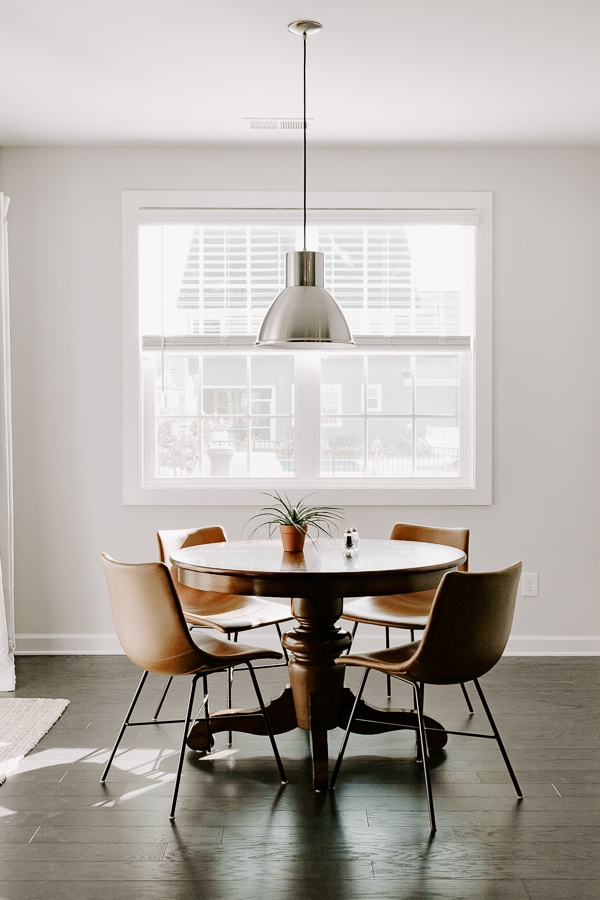 breakfast nook with round table and leather chairs