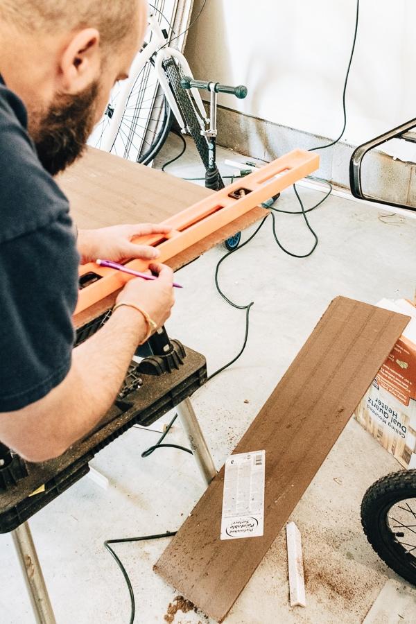 sawing off raw edge of beadboard