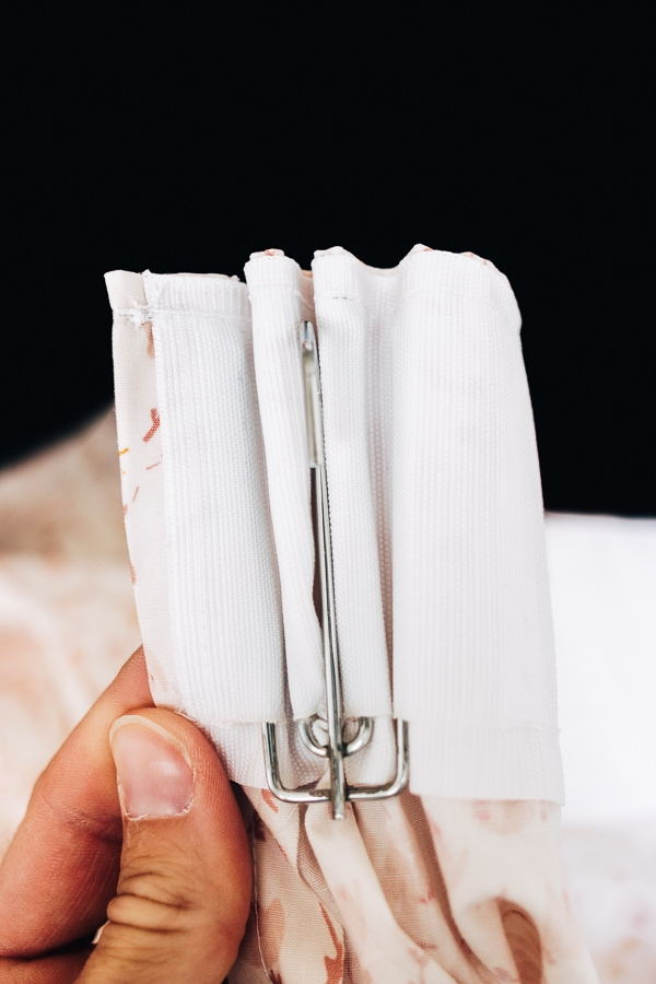 showing how a pinch pleat hook looks in a curtain