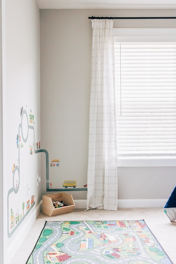 gray boys room with wall decals and windowpane curtains