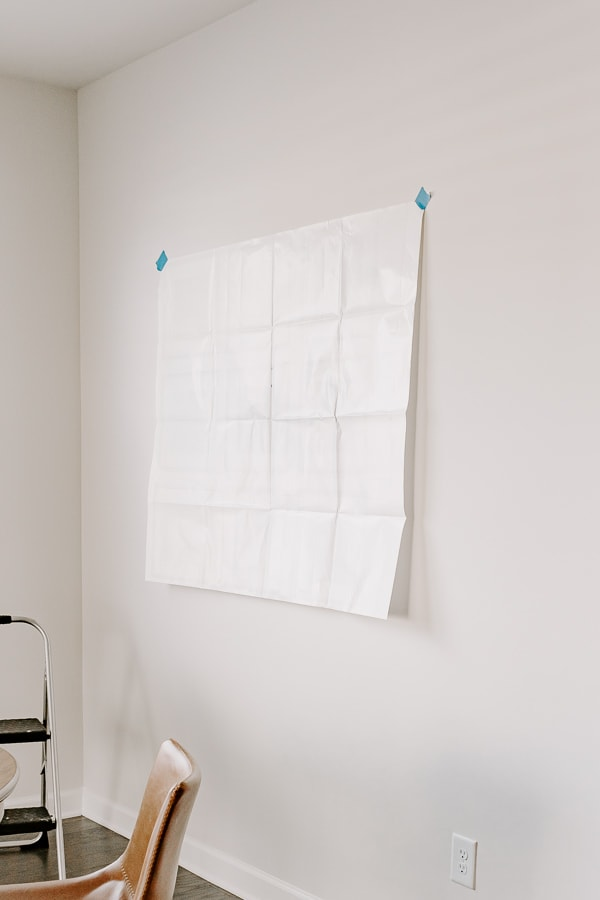 paper gallery wall template hanging on wall with painter's tape