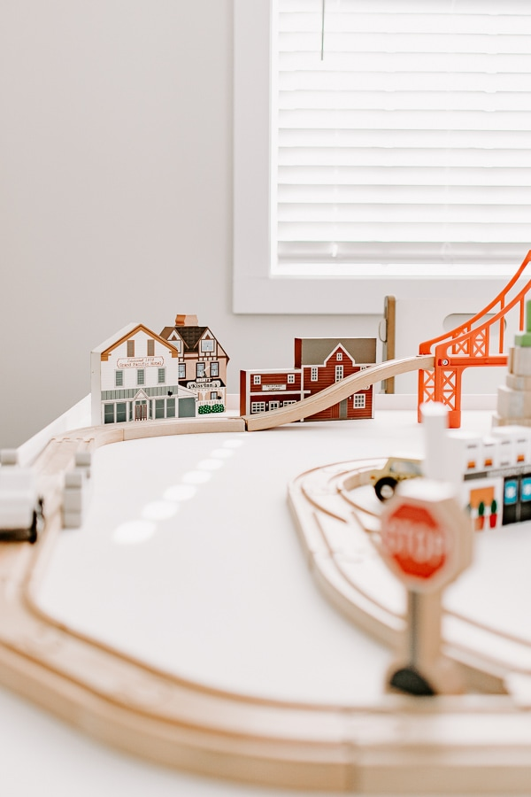 close up of tracks on a white activity table