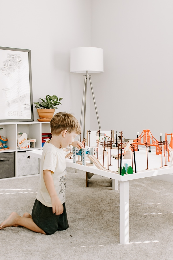little boy playing at an activity table