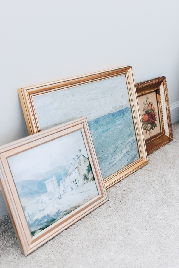 DIY Art Prints against a wall framed in gold frames