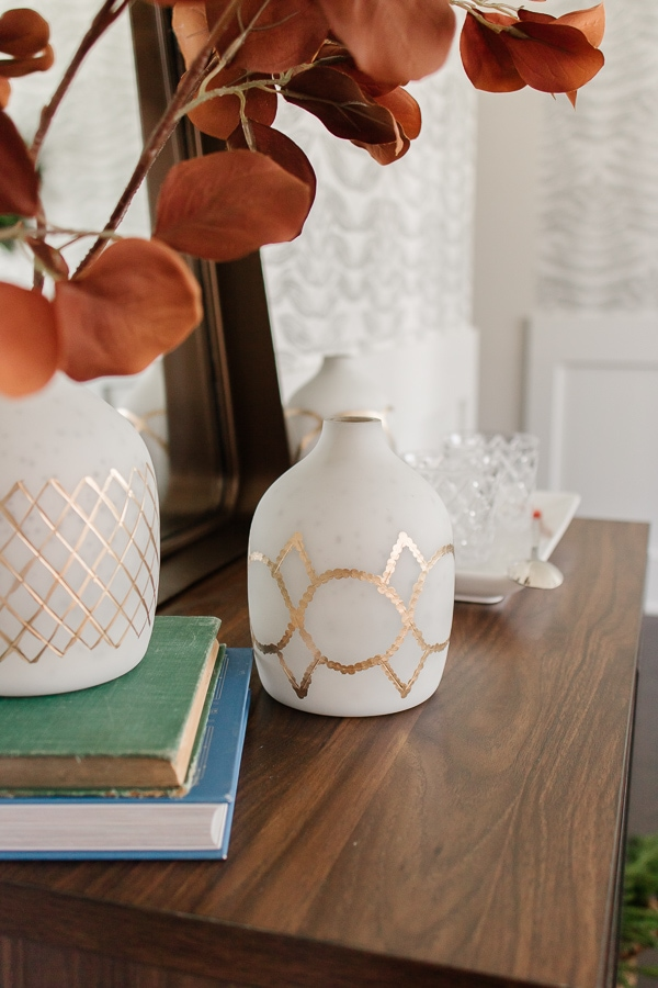 close up of marble vases on a bar cabinet