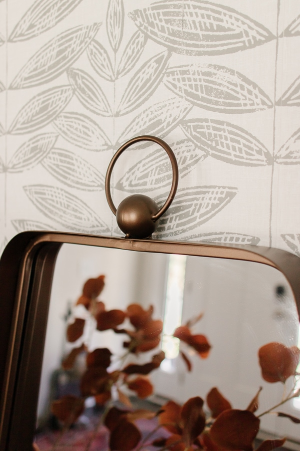 close up of a bronze mirror from rooms to go.