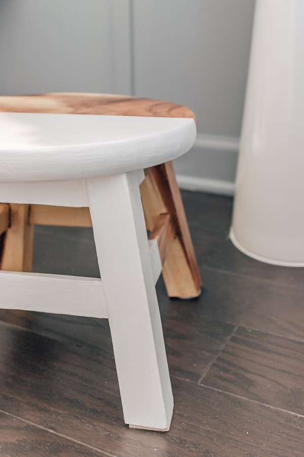 close up picture of a wood and white stool