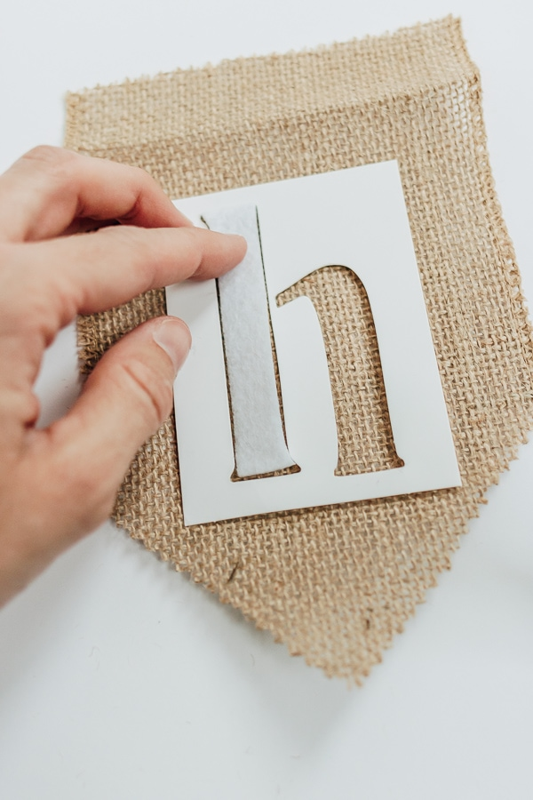 stick letters onto burlap