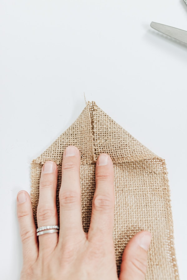 fold down edges to create a perfect point in burlap