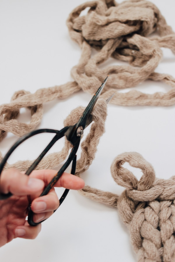 cut excess yarn off from blanket