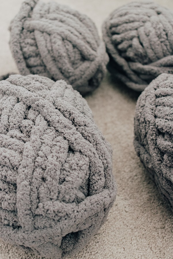 gray jumbo yarn skeins for making a chunky knit blanket