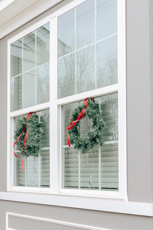 wreaths hanging on windows