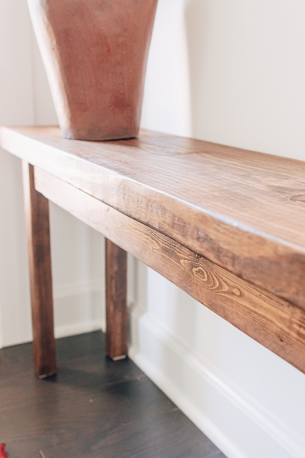 wood bench with a skirt side piece attached