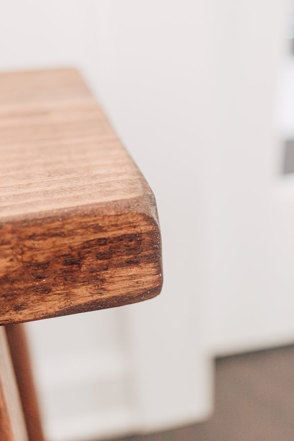 close up of the rounded edges of a wood bench