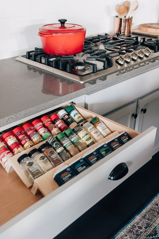 diy wood spice drawer organizer in a drawer with spices on it.