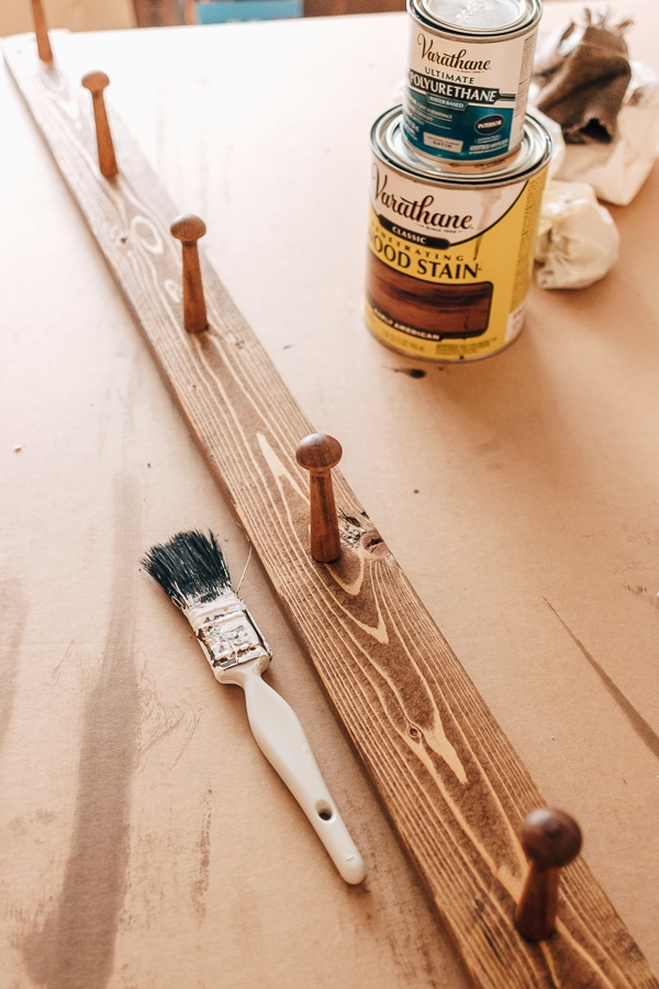 a peg rail being stained