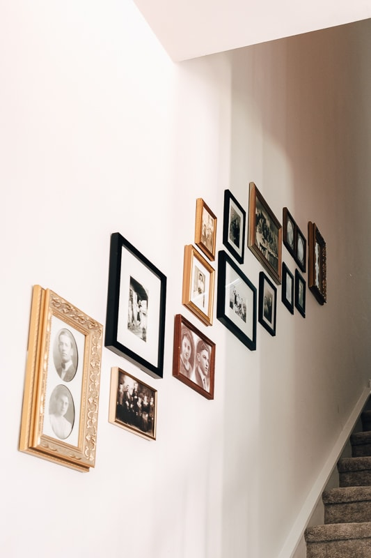 a gallery wall on a stairwell wall