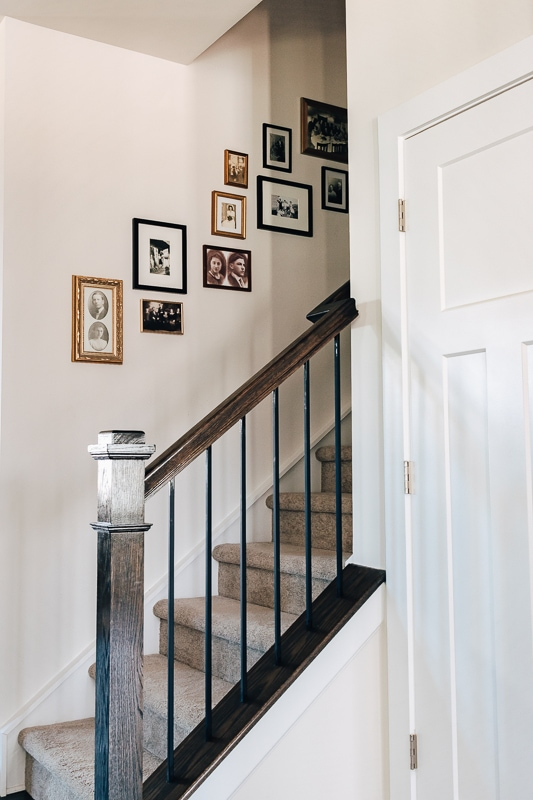 a staircase with a gallery wall