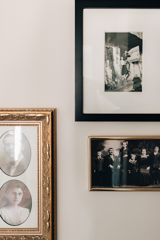 a close up of old photographs in frames