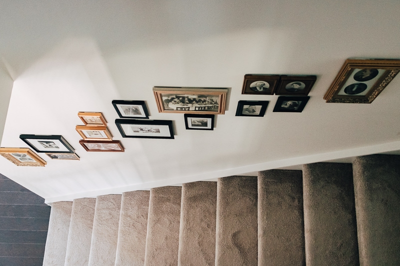 a view of a staircase with a gallery wall from above
