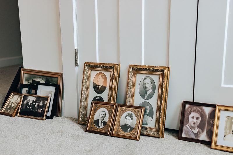 a group of old photographs in antique frames