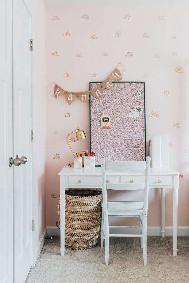 A painted pin board with floral fabric fabric on a white desk - learn how to make a fabric pin board