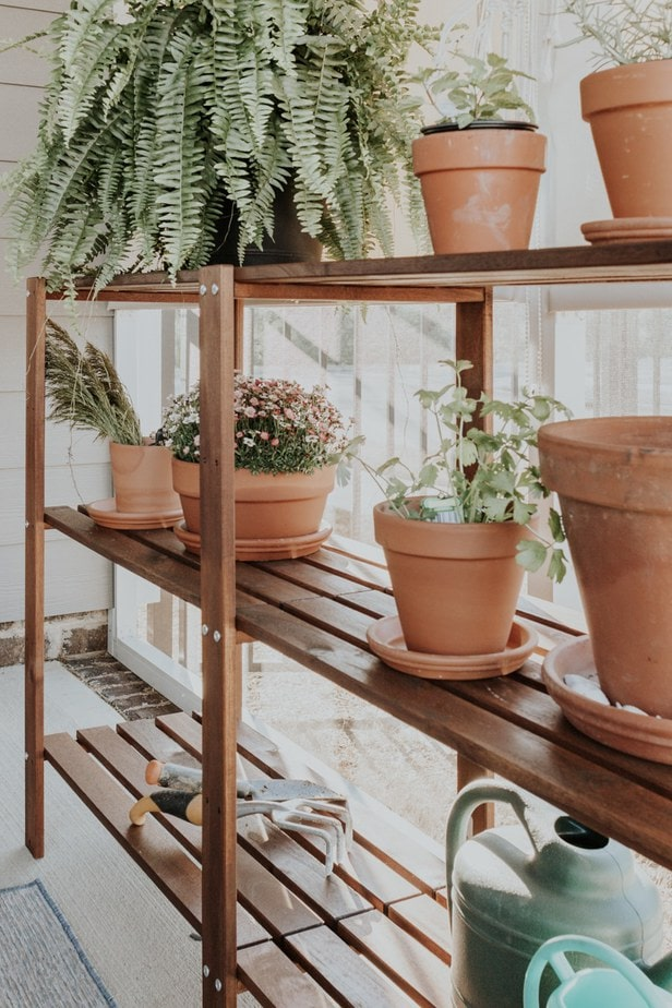 An easy IKEA potting table hack. See how I turned an IKEA shelving unit into a simple potting bench for planting herbs and flowers.