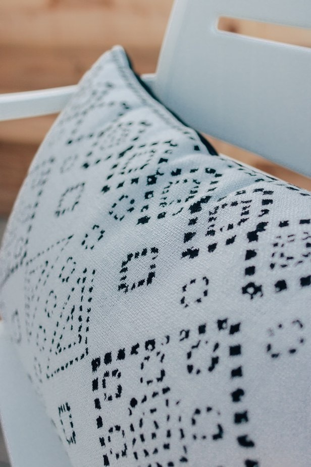 a close up view of a black and white outdoor pillow
