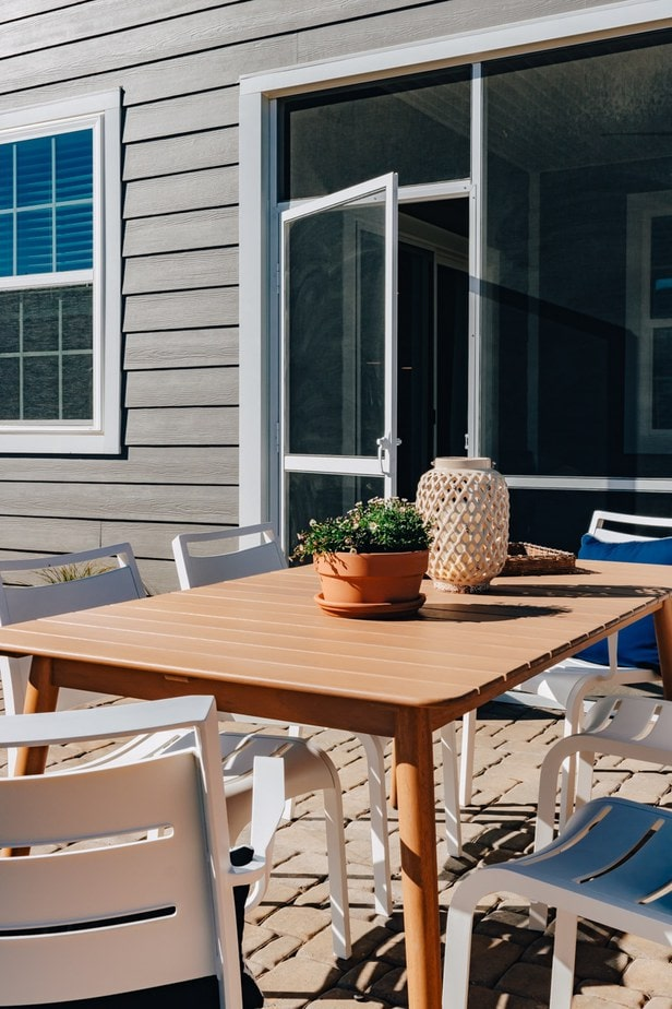 Eucalyptus outdoor dining table with white chairs