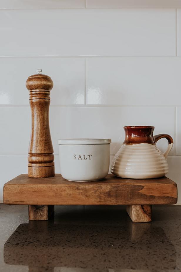 Handmade wood pedestal on a kitchen counter.