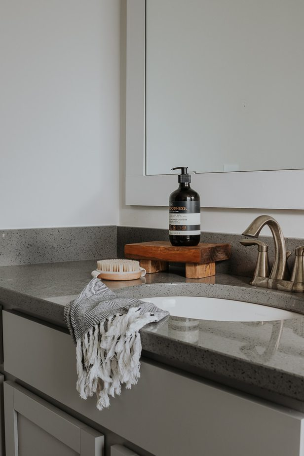 Handmade wood pedestal on a bathroom counter.