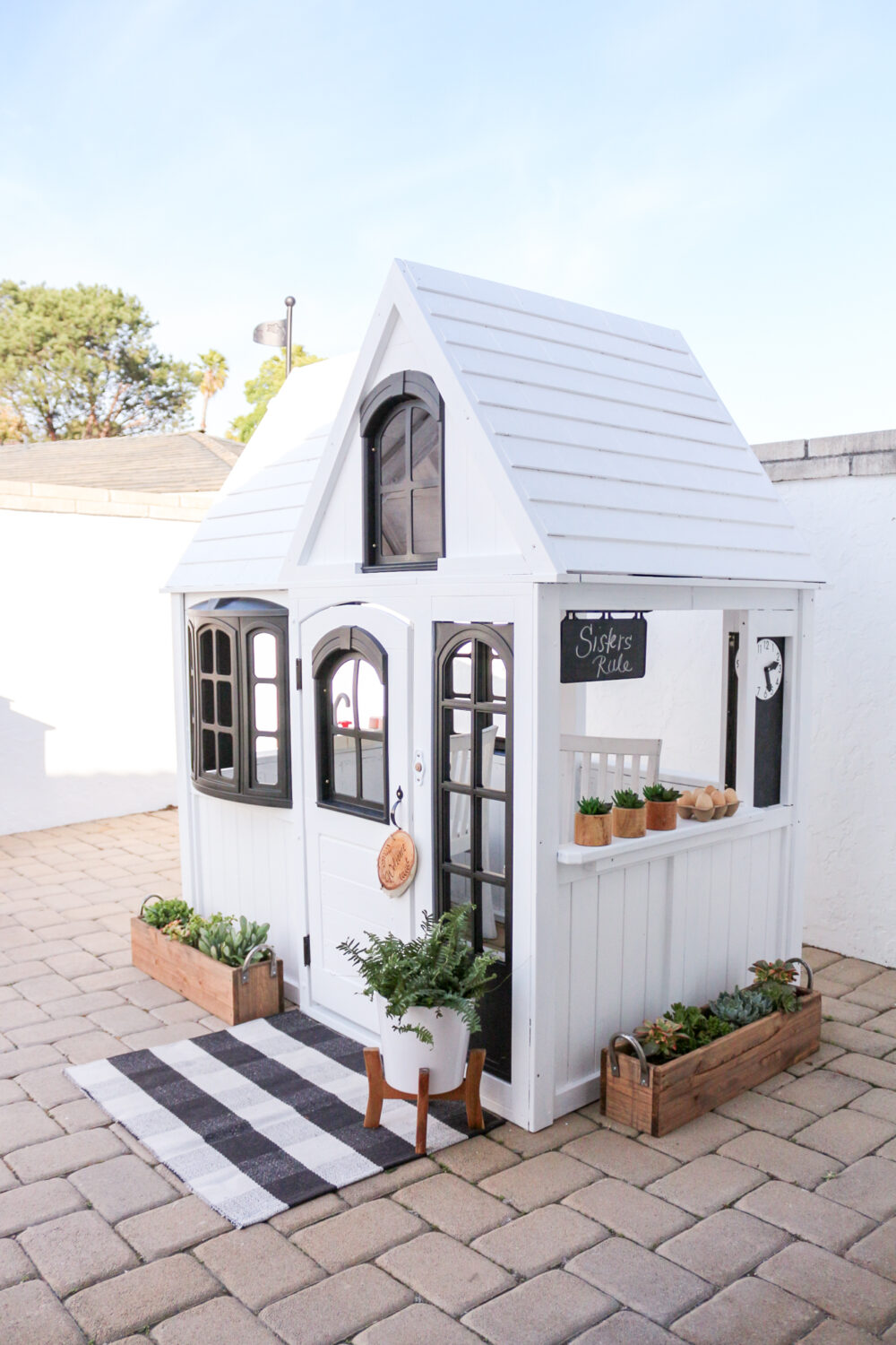 Adorable Farmhouse Playhouse Makeovers - You guys have to see these adorable playhouse makeovers. All it takes is a little creativity, some paint, and some kiddie decorations.