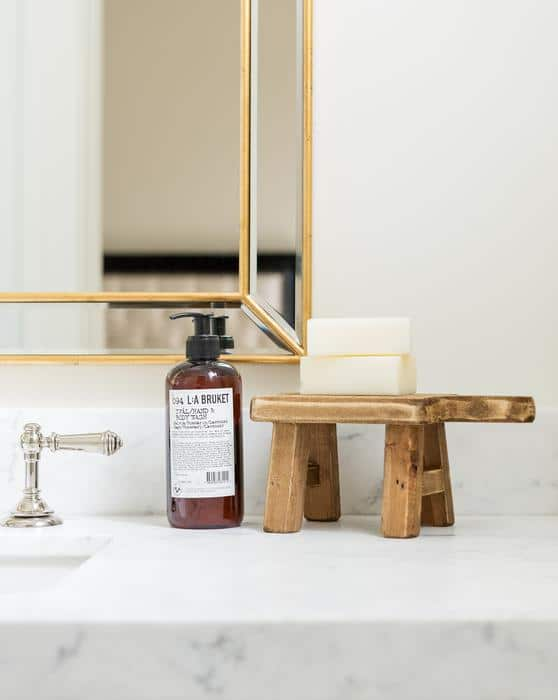 Studio McGee using a wood pedestal on a bathroom counter