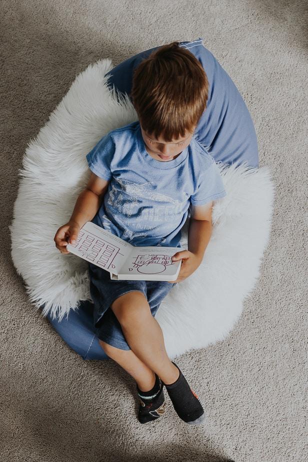 little boy in a diy bean bag chair