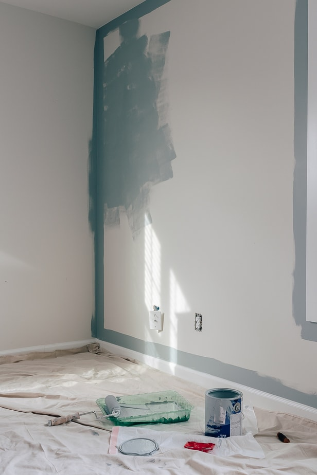a wall with the edges painted blue - how to use a paint edger!
