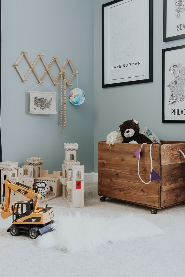 kids wood toy box in a playroom - make this easy diy toy box