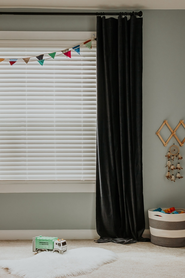 easy way to hang curtains - check out this great tip in post! navy curtains hung with a small truck and gray and white rope basket - kids playroom makeover