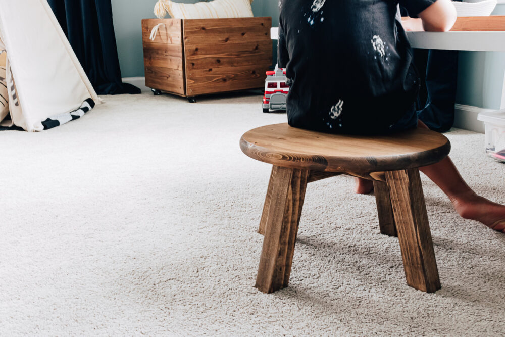 A Small Wood Stool in a Kids Playroom used as a seat