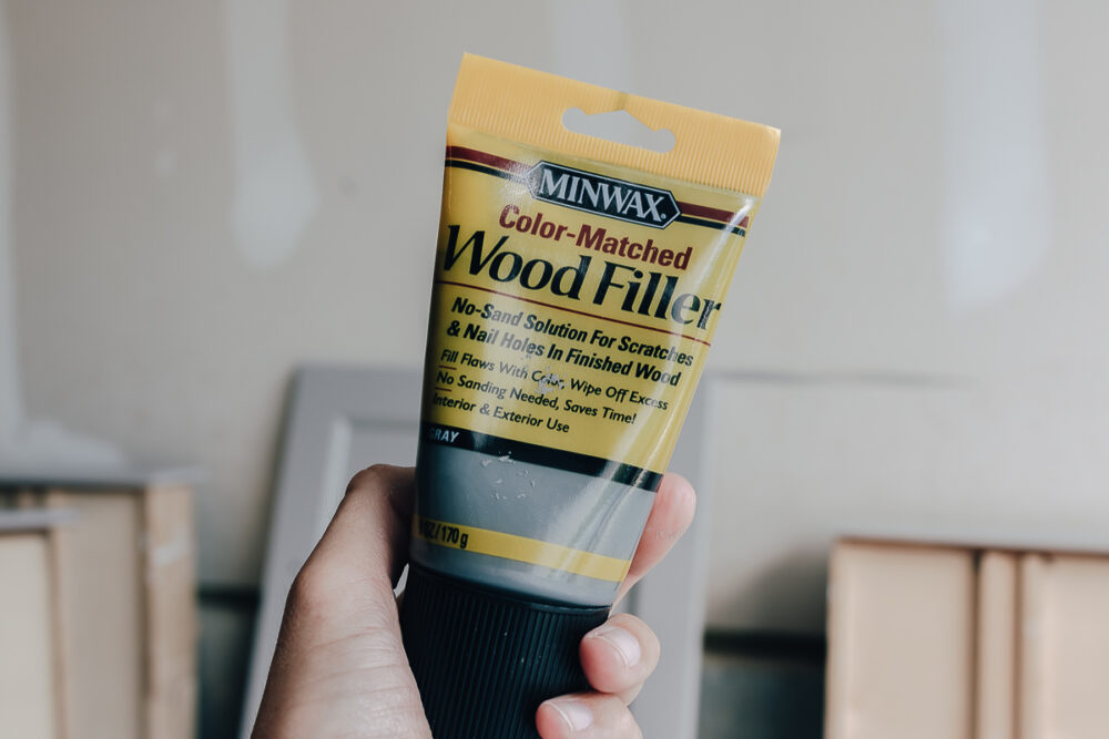 use wood filler to fill in old cabinet holes