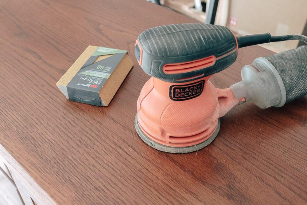 sanding your furniture with an orbital sander