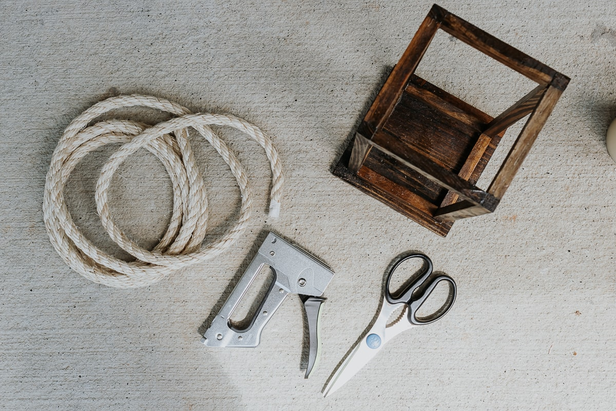 attaching a rope handle to wood lanterns