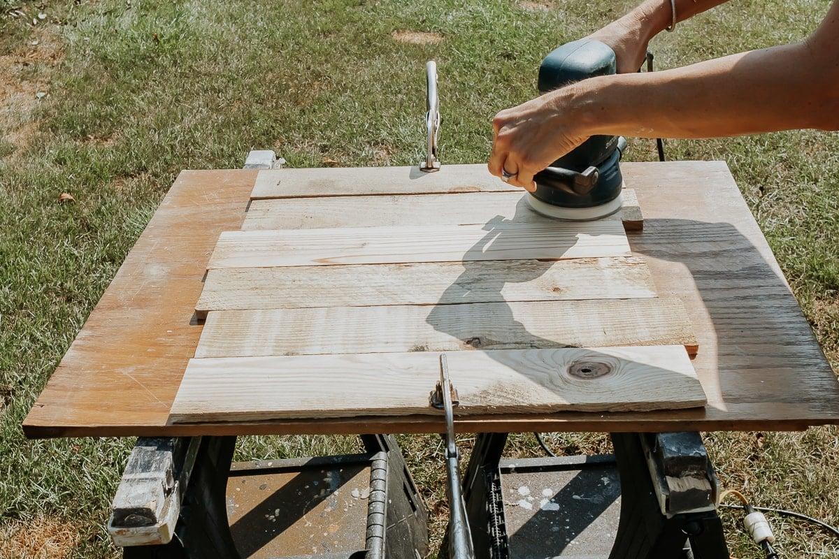 sanding old pallet wood