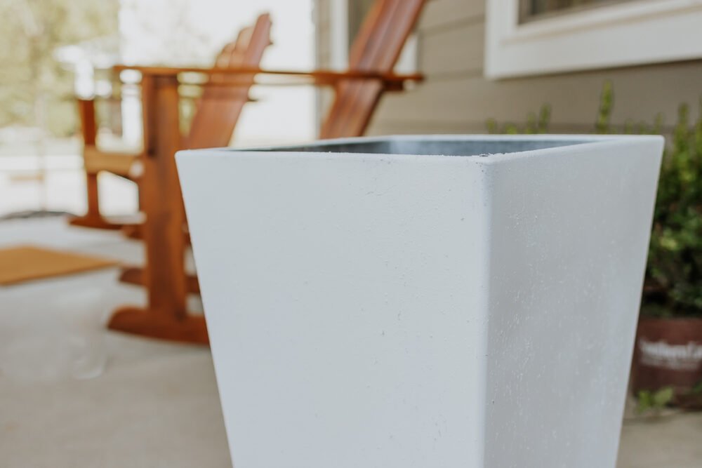 white plastic planter pot on front porch - how to paint outdoor planters - full tutorial in post
